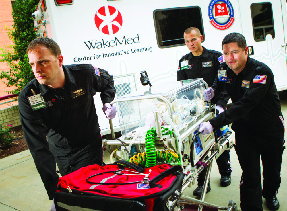 Members of WakeMed Mobile Critical Care Services simulate transporting a critically ill neonate from the ambulance to the unit. Image Credit: WakeMed.