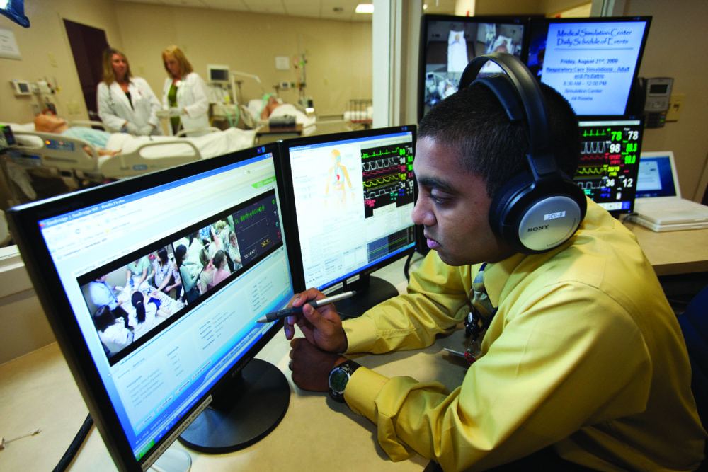 Amar Patel, director of the WakeMed Center for Innovative Learning, runs a simulation experience with a team of nurses from the ICU control room. Image Credit: WakeMed