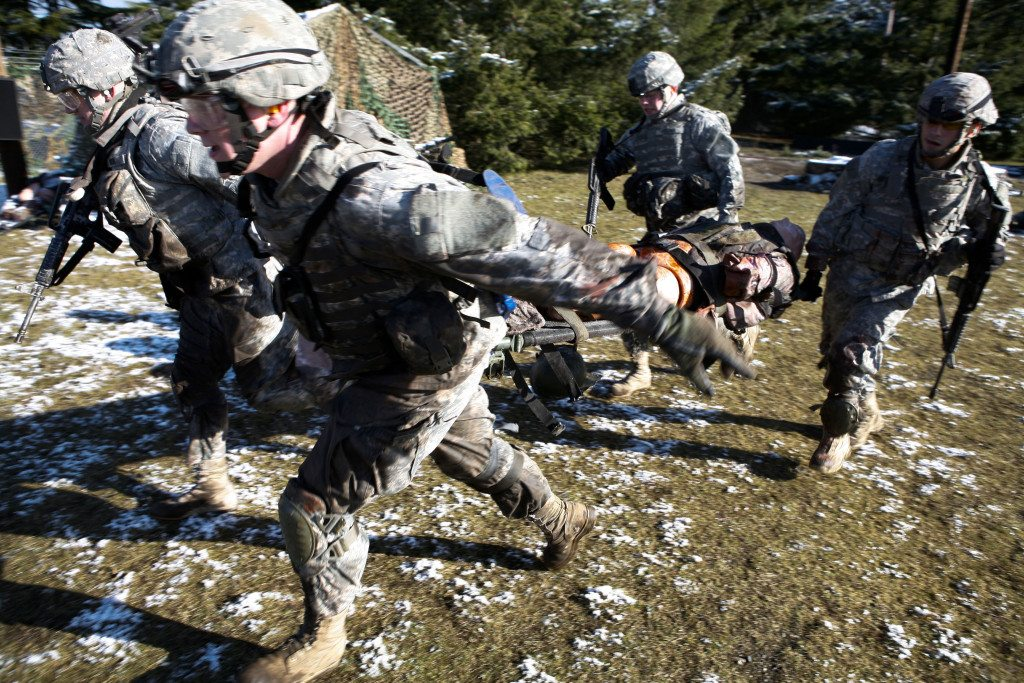 Soldiers carry a simulated battlefield casualty during a training exercise at the Fort Lewis Medical Simulation Training Center. (Photo: US Army/ Phil Sussman)