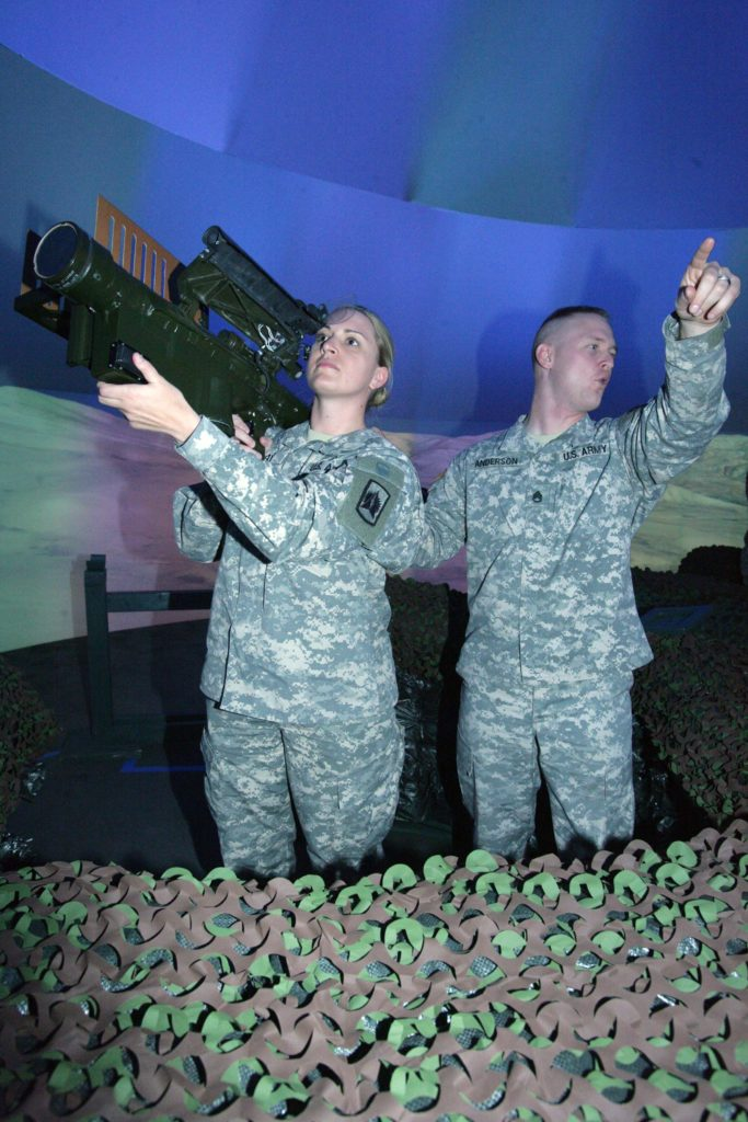 Staff Sgt. Jessica Ray sights in a stinger missile on virtual enemy aircraft. Image Credit: James Brabenec/ Fires Center of Excellence, Fort Sill.