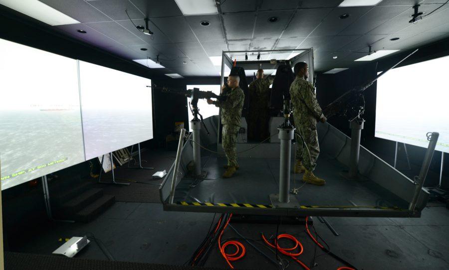 Sailors assigned to Coastal Riverine Squadron (CRS) 3 participate in an Embarked Security Team (EST) training scenario using the Laser Shoot Combat Simulator. EST's provide force protection to noncombatant Military Sealift Command vessels and contracted ships around the world. (U.S. Navy photo by Mass Communication Specialist 2nd Class Joshua Scott/Released)