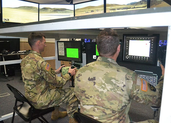 Soldiers operate the Combined Arms Virtual Collective Trainer at the Combined Arms Center