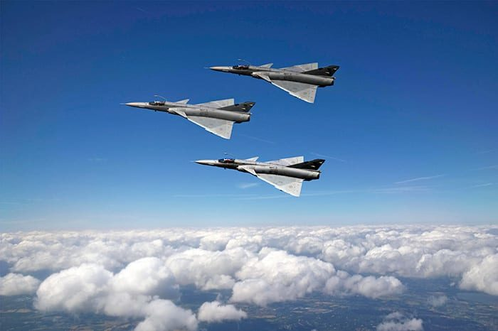 Three of Draken's refurbished ex-South African Air Force Atlas Cheetah-Cs in Vic formation.