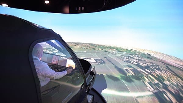 MS&T Europe Editor Dim Jones flying Lockheed Martin's FLV simulator.