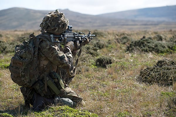 A soldier of First Fusiliers operating a LMG during a section level attack.