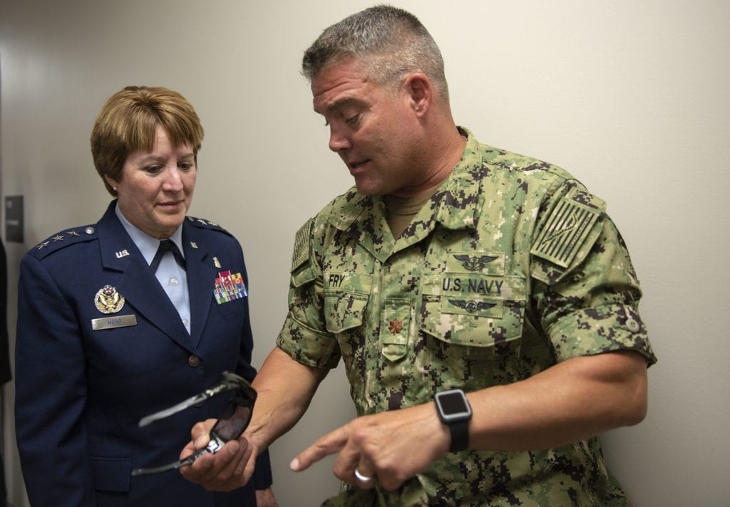 Lt. Gen. Dorothy Hogg, Air Force Surgeon General, talks with a US Navy sailor during a tour of the Air Force's first Invisible Wounds Center Aug. 30 at the Eglin Air Force Base, Fla. The IWC will serve as a regional treatment center for post-traumatic stress, traumatic brain injury, associated pain conditions and psychological injuries.