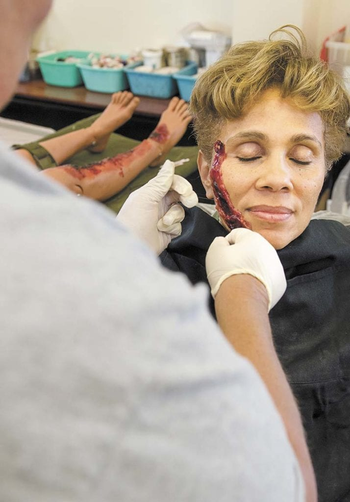 Lt. Gen. Nadja West, U.S. Army Surgeon General, and U.S. Army Medical Command commanding general, receives an artificial face and hand injury as she visits the moulage facilitate at Fort Hunter Liggett, Calif., during a tour of the center. Source: Fort Bliss Bugle