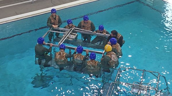Briefing in the pool prior to using Short-Term Air Supply Systems (STASS) personal air bottles.