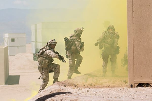 """Live training events such as this USMC urban patrol exercise are becoming more focused on preventing """"collateral damage"""" to civilians in combat zones."""