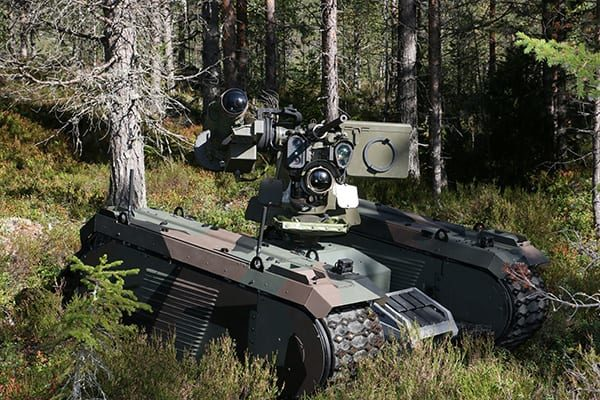 The Titan/THeMIS UGV with a Kongsberg Defence and Aerospace PROTECTOR remote weapon station.