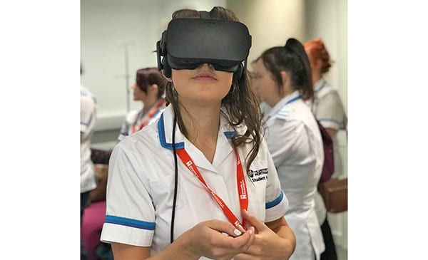 Nursing student at the University of Northampton trying out the OMS virtual reality platfrom. Image credit: OMS/University of Northampton Nursing.