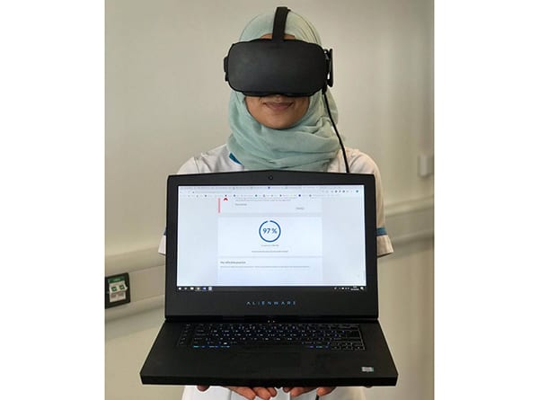 Nursing student at the University of Northampton with feedback from their OMS virtual reality simulation. Image credit: OMS/University of Northampton Nursing.