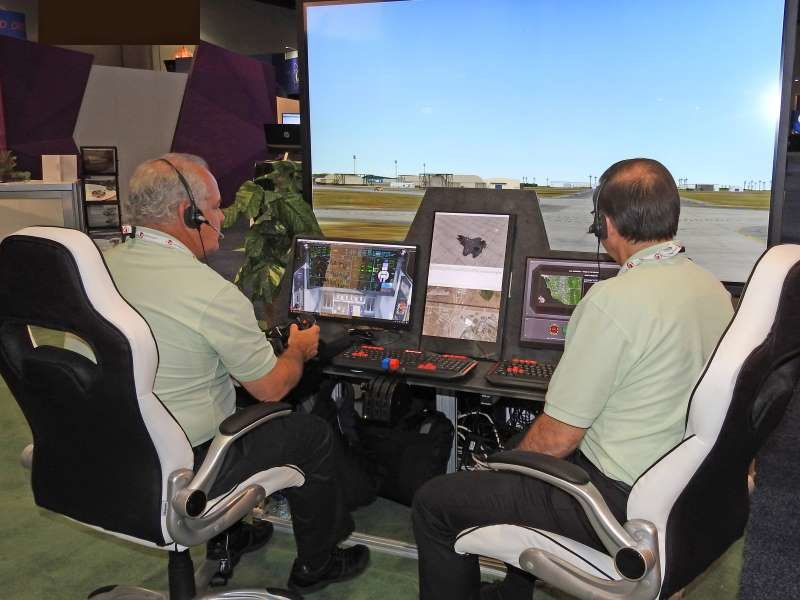 During 2017 I/ITSEC, John Merwin (left) and Nick Papadopoli (right) demonstrated Adacels's ATCiB Simulated ATC Environment for delegates.