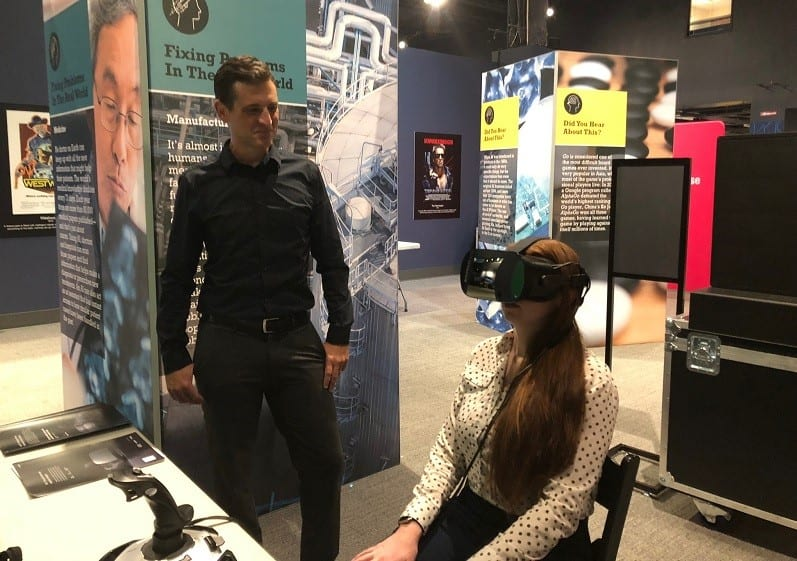 Varjo Technical Support, North America, Miles Heckendorn (left) shows Halldale Industry Reporter Amanda Towner the Varjo VR-1 headset.