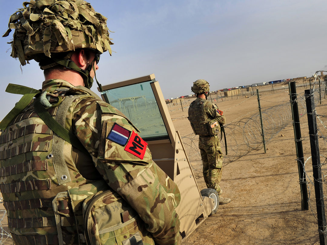 RAF Police guard the main entry point of Camp Bastion during Op Herrick, Afghanistan.