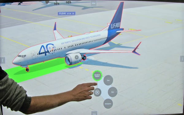UFA's ATLive interactive tabletop training tool is part of a comprehensive ATC training complex, including aerodrome simulator, for the Civil Aviation Authority of Singapore. Image credit: UFA.