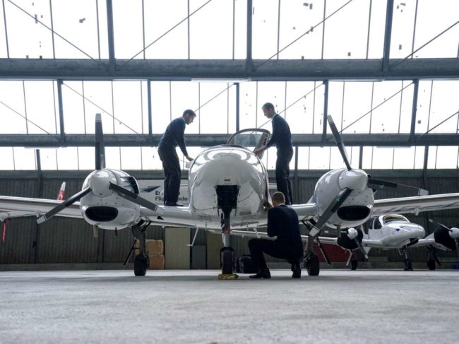 Ab initio students inspect a Diamond aircraft at the European Flight Academy in Grenchen, Switzerland.