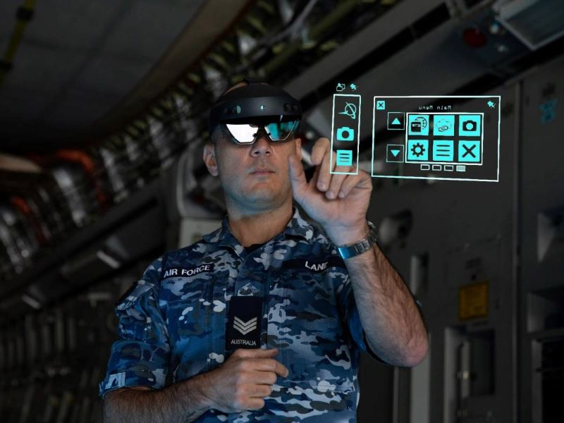 Sergeant thomas lane from no 36 squadron uses the hololens mixed reality device