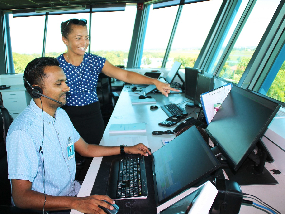 Air traffic controllers stanley prakash and jackie tabua using the new aurora atm system in the nadi tower z low res