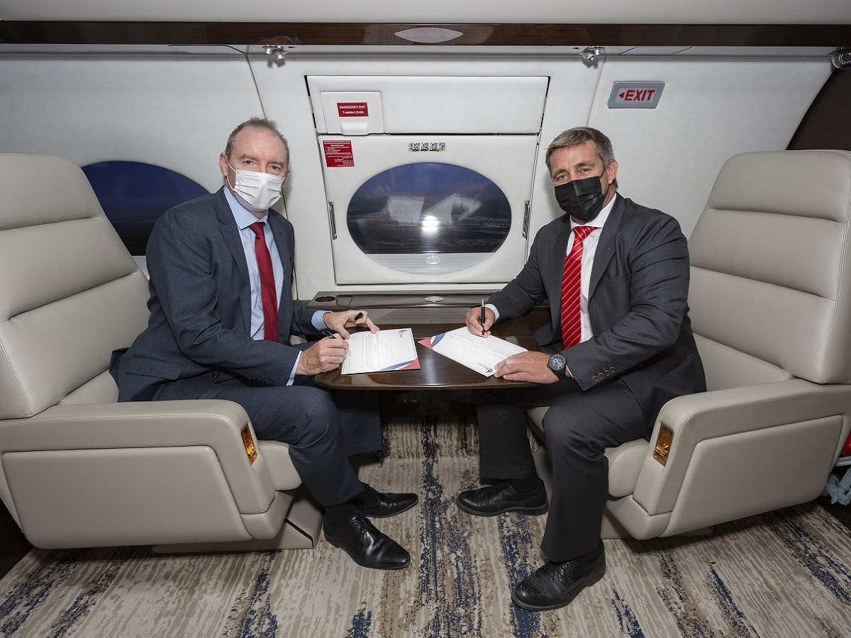 Signing ceremony in a plane