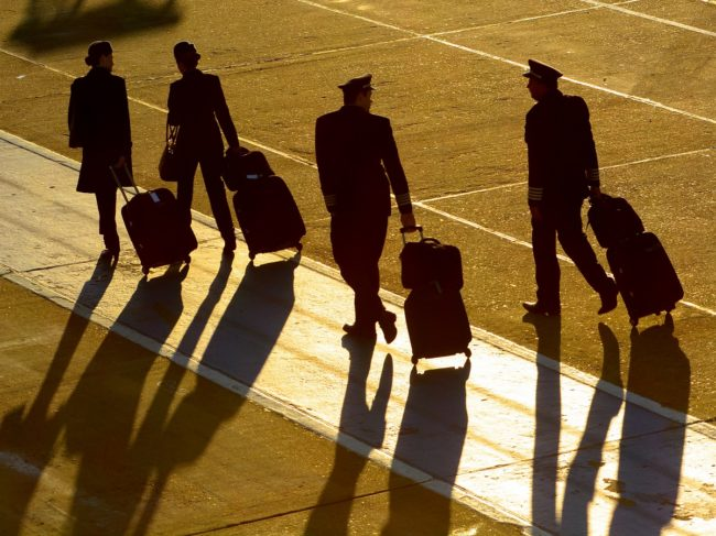 Pilots Walking Away with Bags